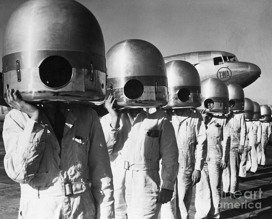 Mechanics With Propeller Hubs On Heads Photograph by Bettmann