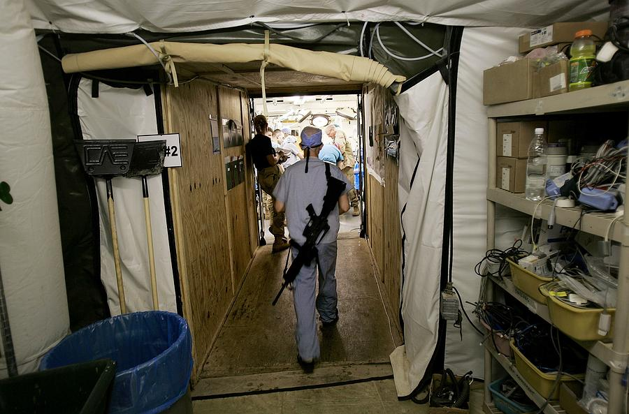 Medical Personnel At Balad Trauma Photograph by Chris Hondros