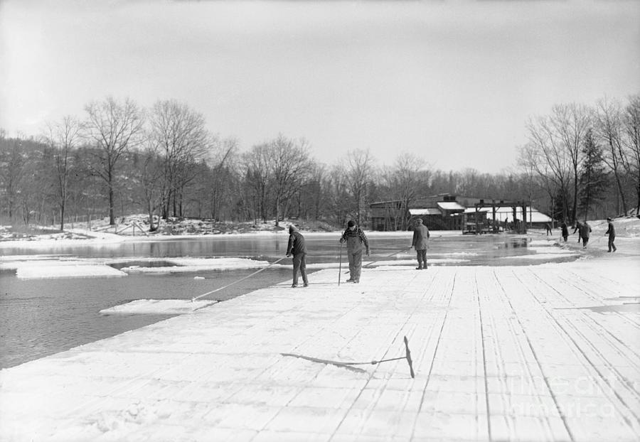 Men Gathering Ice From Frozen Pond Photograph by Bettmann