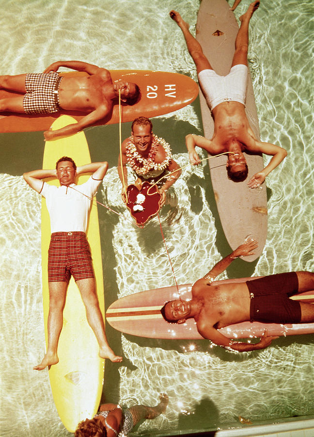 Men On Surfboards In Pool Sipping Drinks Photograph by Tom Kelley Archive