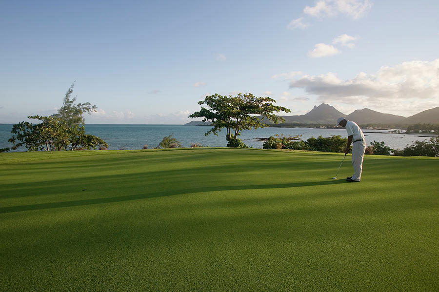 Men Playing Golf On Le Touessrok Golf Photograph by Holger Leue