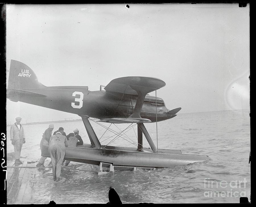 Men Pushing Curtiss Racing Plane Photograph by Bettmann