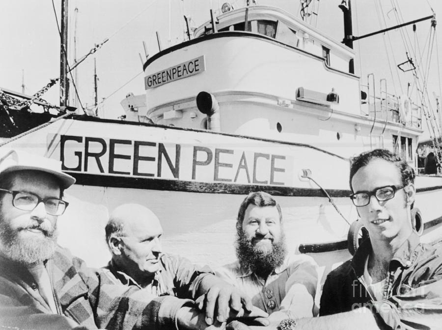 Men Seated Near Greenpeace Vessel Photograph by Bettmann