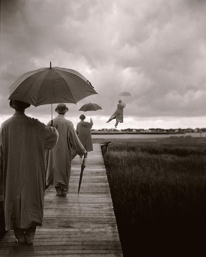 Men With Umbrellas Flying  Into Sky Photograph by Bryce Lankard
