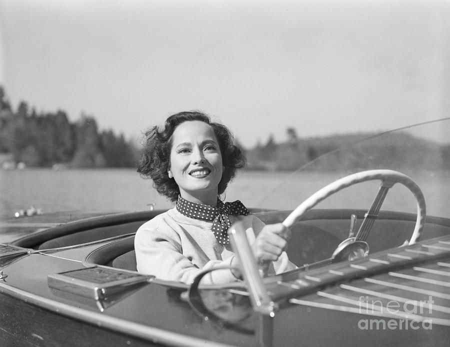 Merle Oberon Driving A Motorboat Photograph by Bettmann