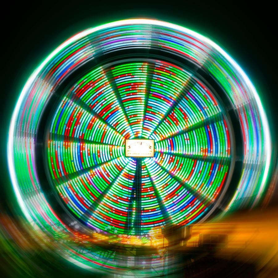 Farris Wheel Photograph - Mesmerizing Farris Wheel  by Christine Buckley