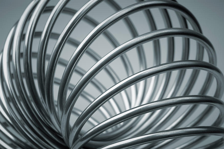 Metal Coil Spiraled In The Form Of A Photograph by Nikamata