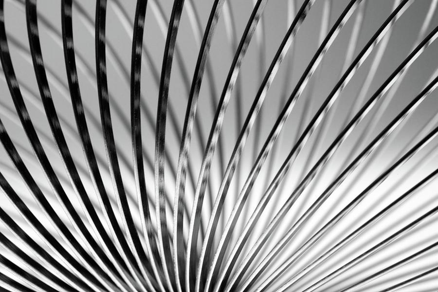Metal Slinky Photograph by Deceptive Media