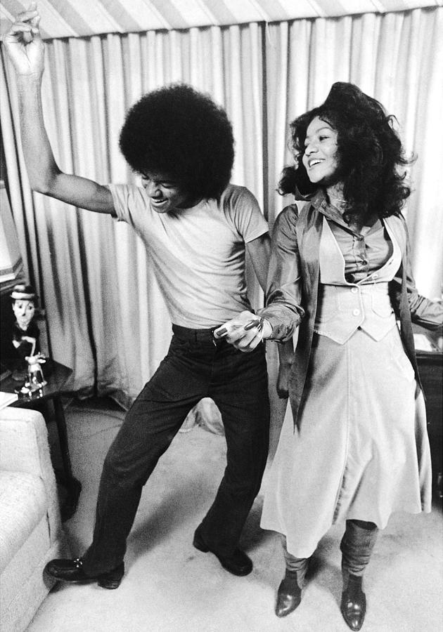 Michael Jackson Dances With His Photograph by New York Daily News Archive