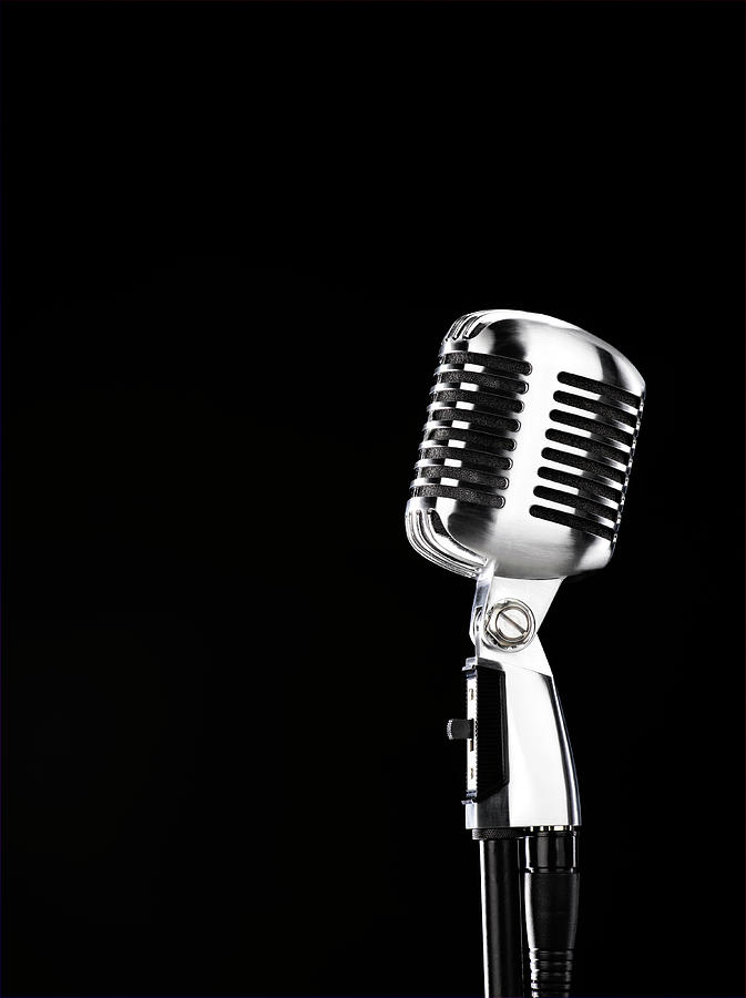 Microphone Against Black Background Photograph by Peter Dazeley