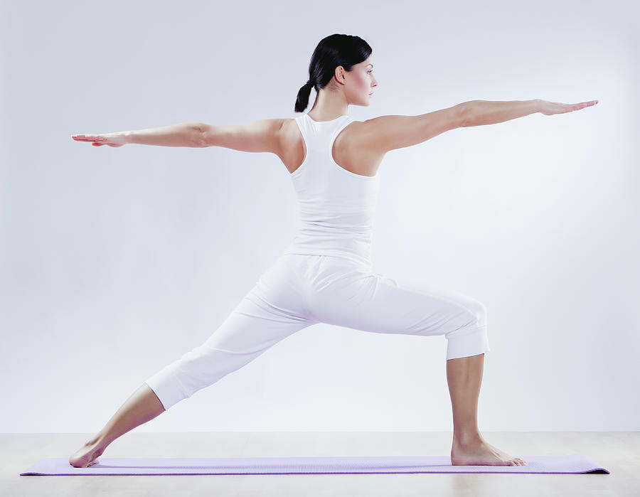 Mid Adult Woman Doing Yoga Against Photograph by Westend61
