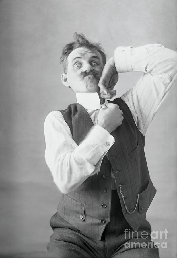 Middle-aged Man Adjusting Collar Photograph by Bettmann