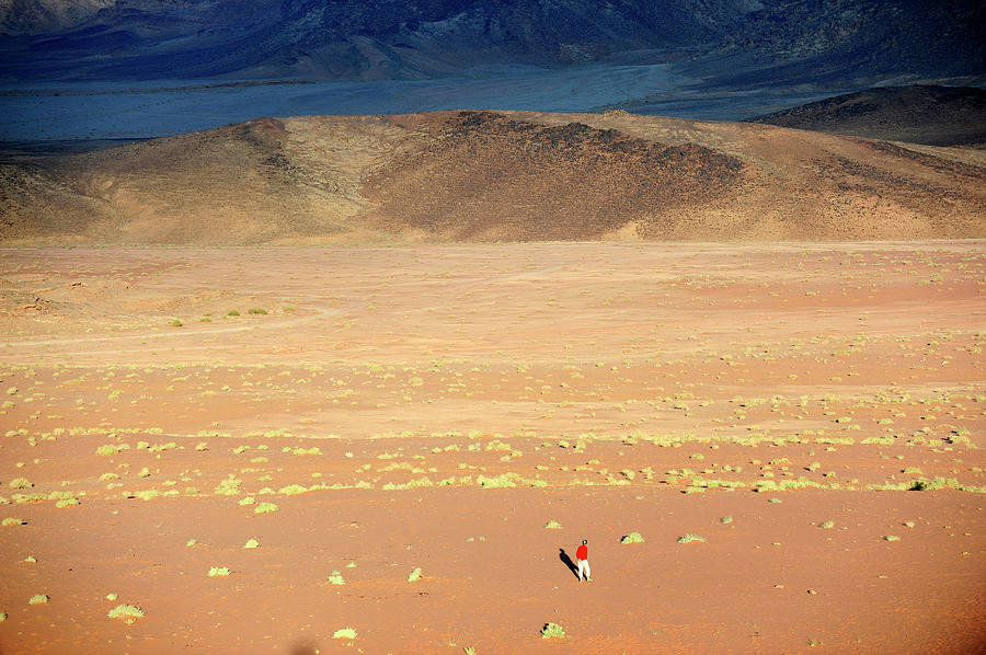 Middle East,jordan,man Walking In A Photograph by Frédéric Soreau