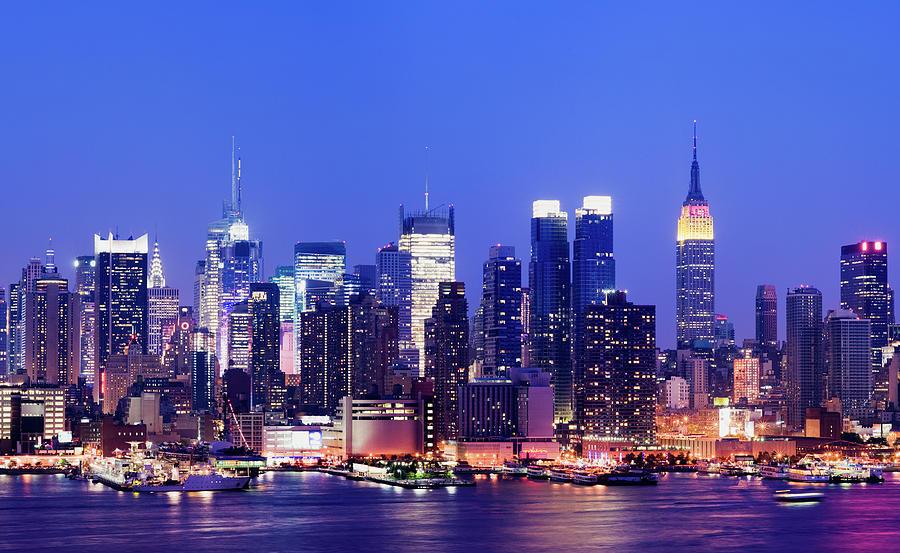 Midtown Manhattan City Skyline At Night Photograph by Deejpilot