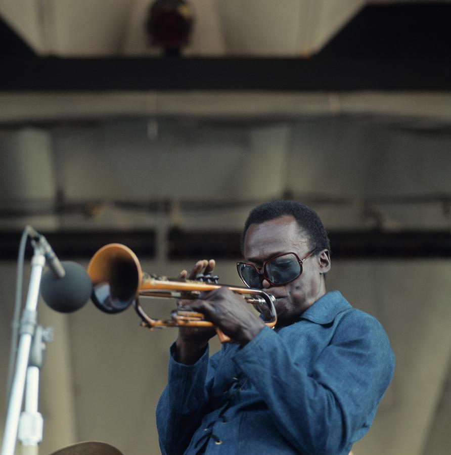 Miles Davis Performs At Newport Photograph by David Redfern