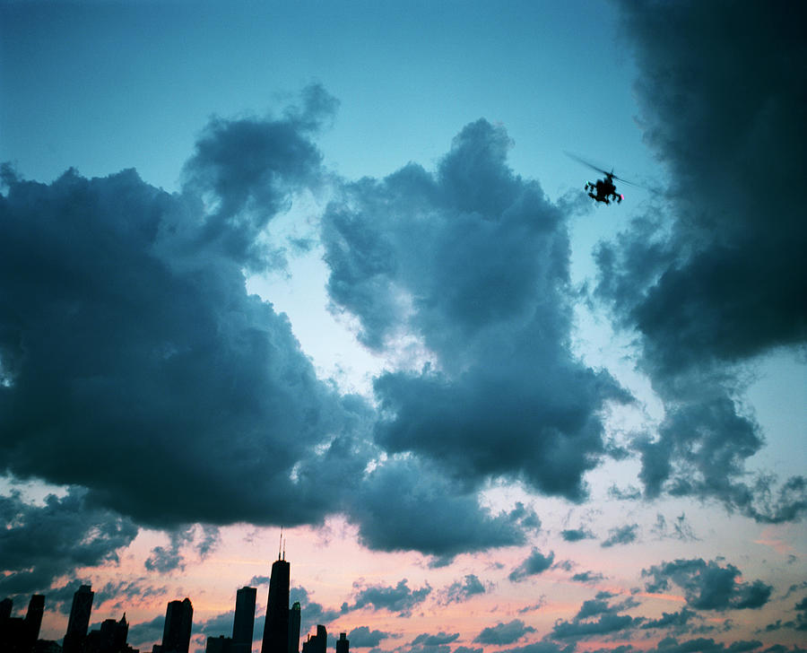 Military Helicopter Above City Photograph by Seth Goldfarb