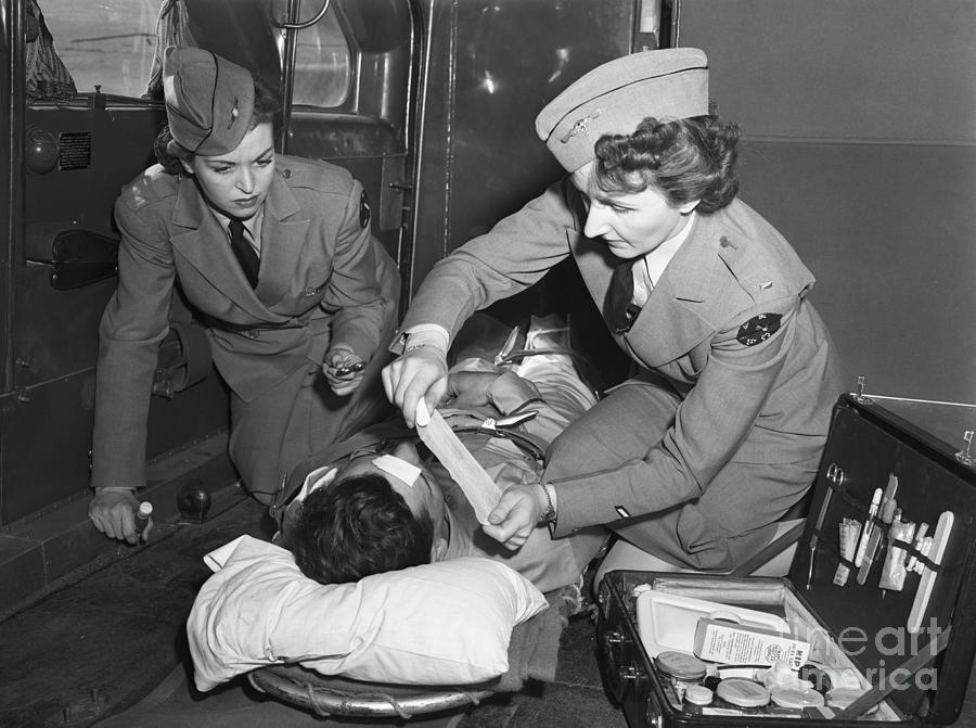Military Nurses Treating Wounded Soldier Photograph by Bettmann