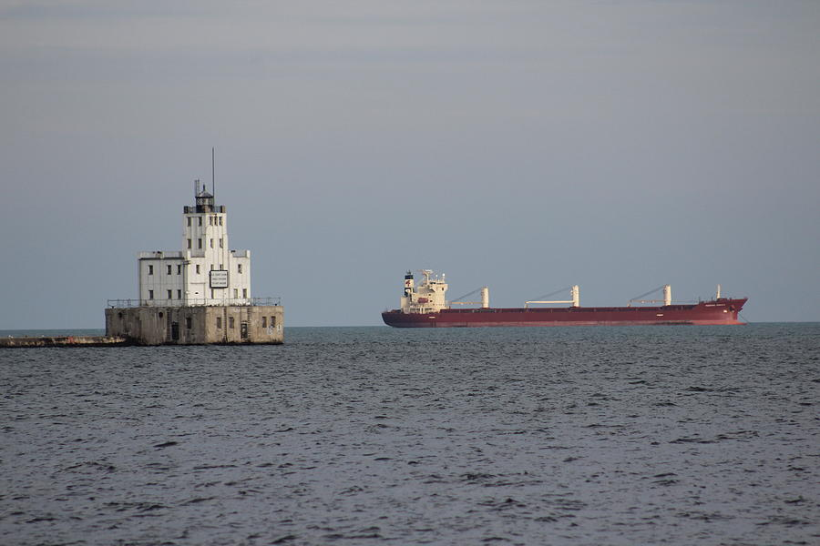 Lighthouse Photograph - Milwaukee Breakwater Light And Ship by Callen Harty