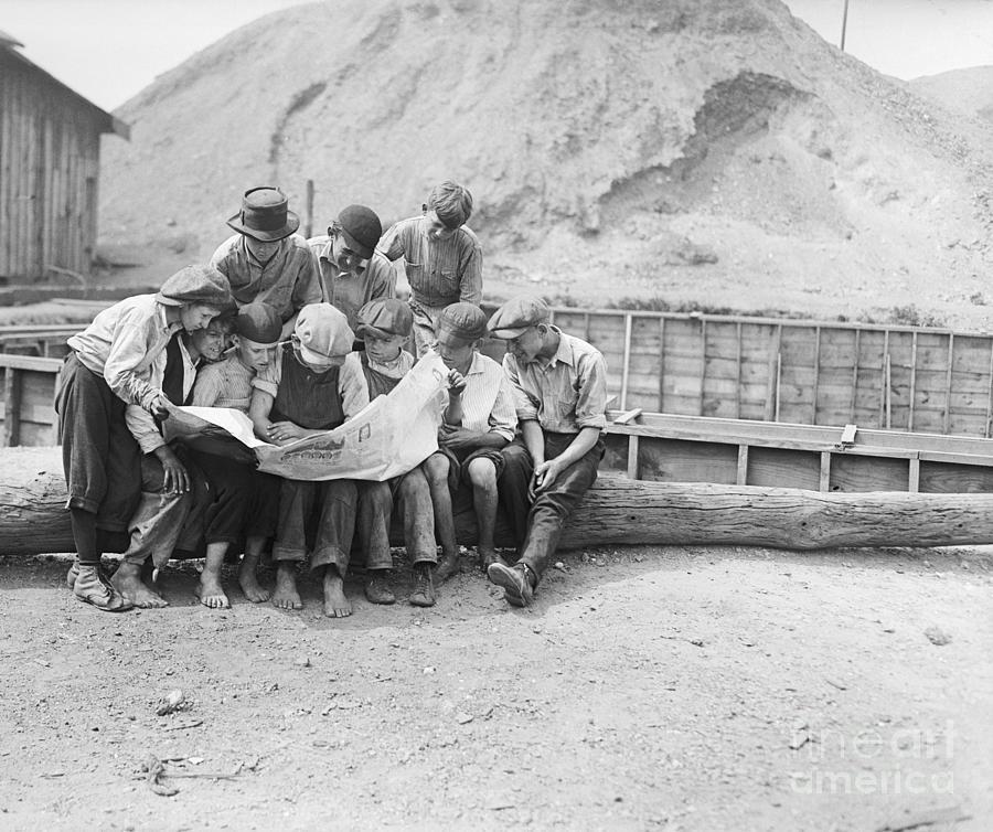 Miners Children Reading Newspaper Photograph by Bettmann