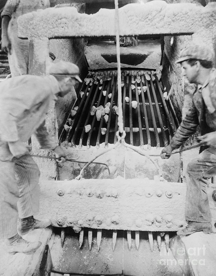 Miners Crushing Salt Photograph by Bettmann