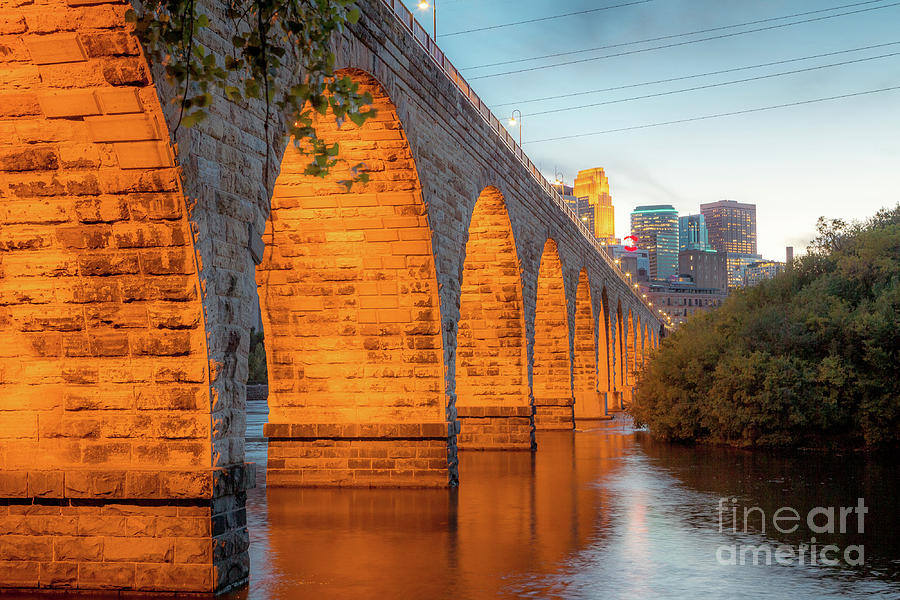 Minnesota Photograph - Minneapolis Skyline and the Stone Arch Bridge  by Habashy Photography
