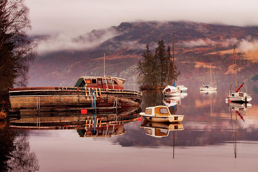 Misty morning reflections of Loch Ness by Ian Middleton