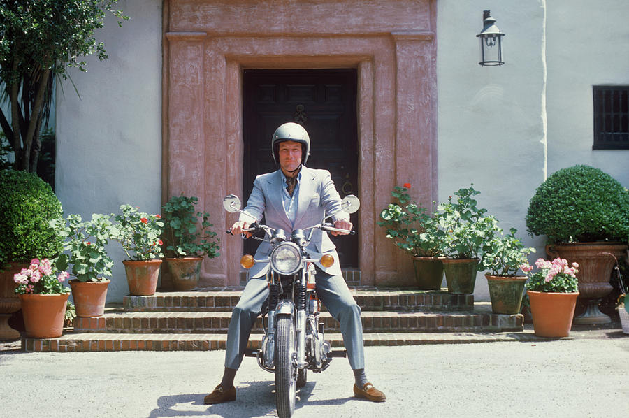 Mitchell On Motorcycle Photograph by Slim Aarons