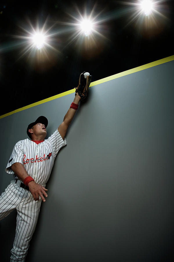 Mixed Race Baseball Player Catching Ball Photograph by Hill Street Studios