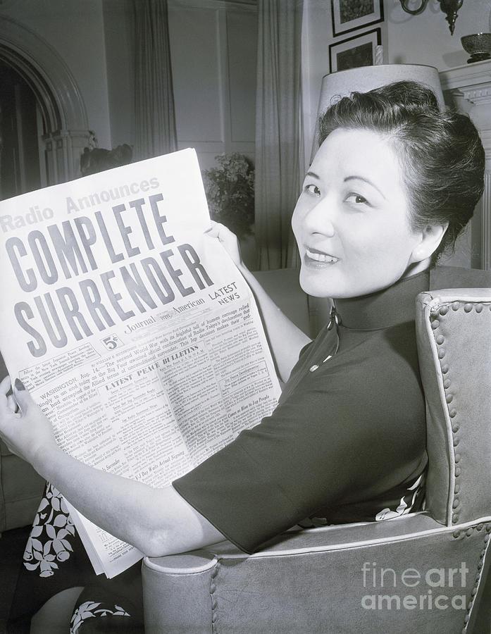 Mme. Chiang Kai-shek Looking At Headline Photograph by Bettmann