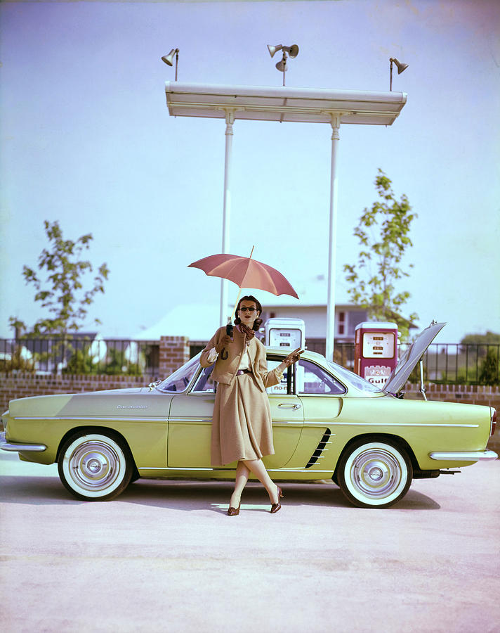 Model in Front of a Gold Renault Caravelle Photograph by Jerry Schatzberg