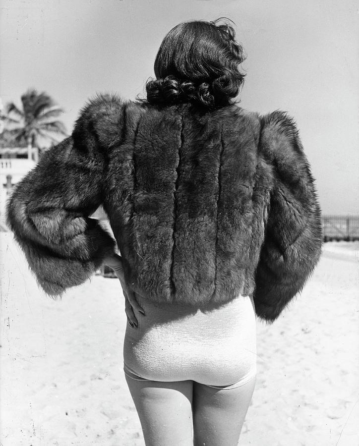 Model Wearing Fur Jacket Over Bathing Su Photograph by Alfred Eisenstaedt