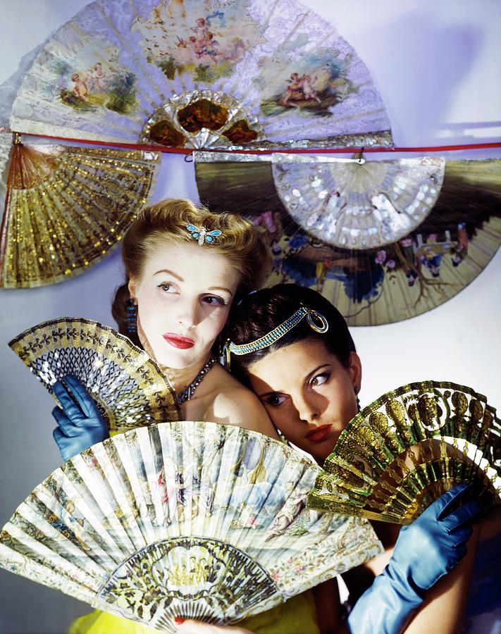 Models In Max Factor With Fans Photograph by Horst P. Horst