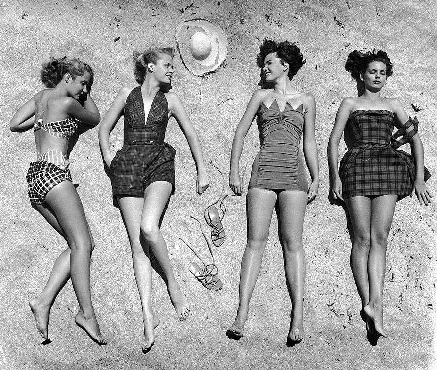 Models Lying On Beach To Display Photograph by Nina Leen