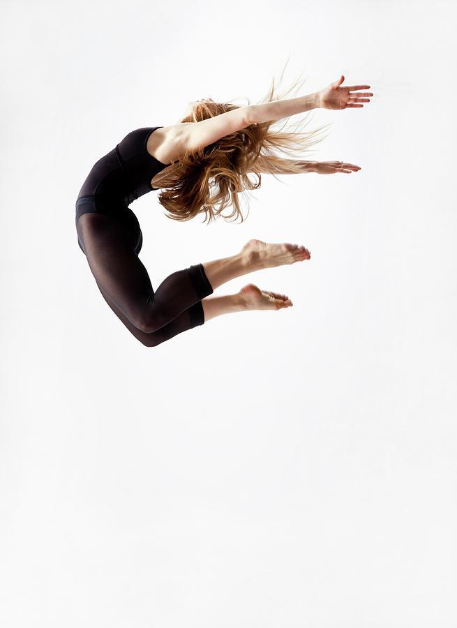Modern Dancer Jumping In The Air Photograph by Jonya