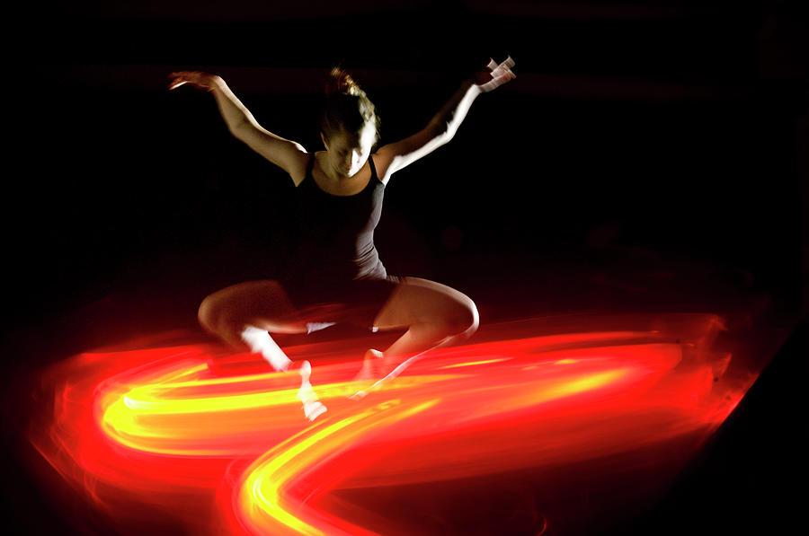Modern Dancer Leaping Above Orange Photograph by John Rensten