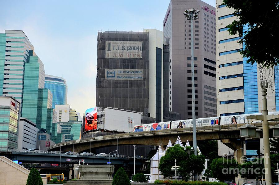 Modern urban image with BTS skytrain transport and skyrise buildings central Bangkok Thailand by Imran Ahmed