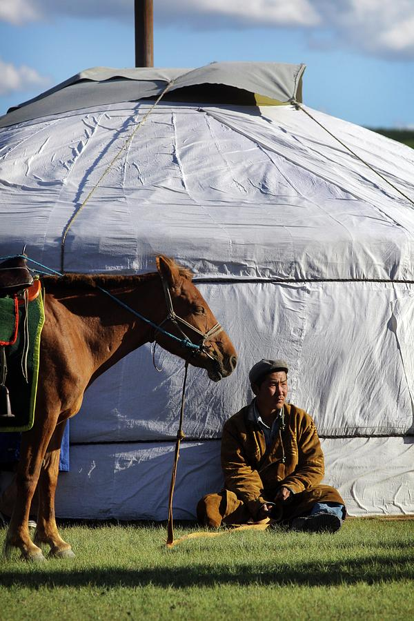 Mongolian Herder Sits Outside Ger With Photograph by Timothy Allen