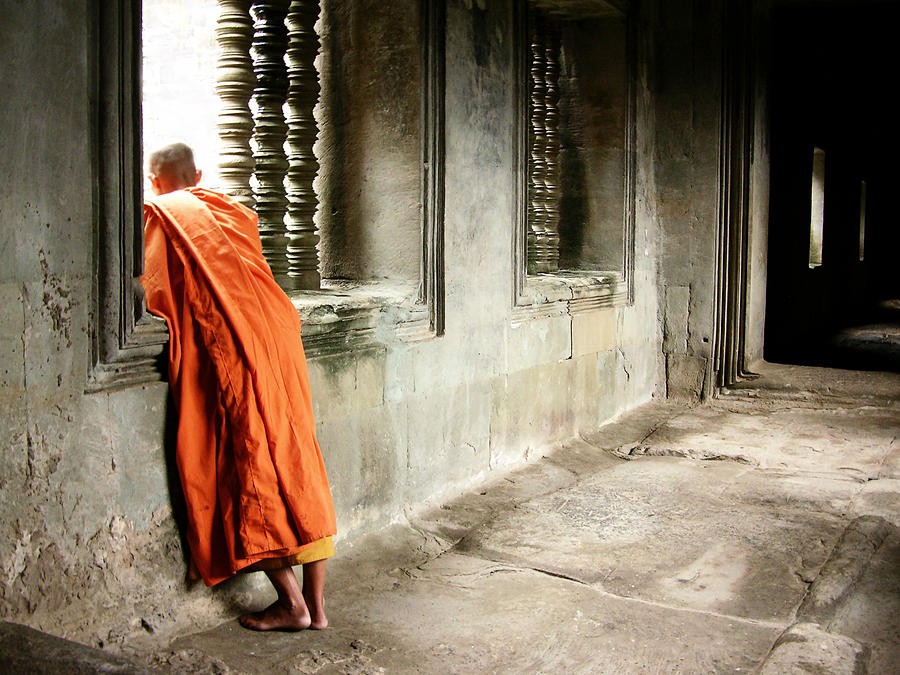 Monk In Orange Robe Looking Out Window Photograph by Lore