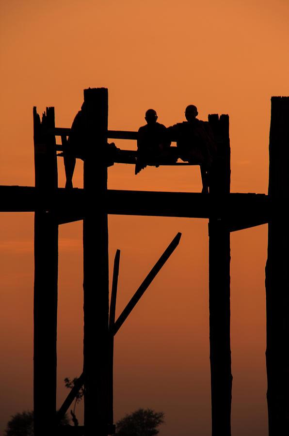 Monks Resting On Uben Bridge - Myanmar Photograph by Copyright Pascal Carrion