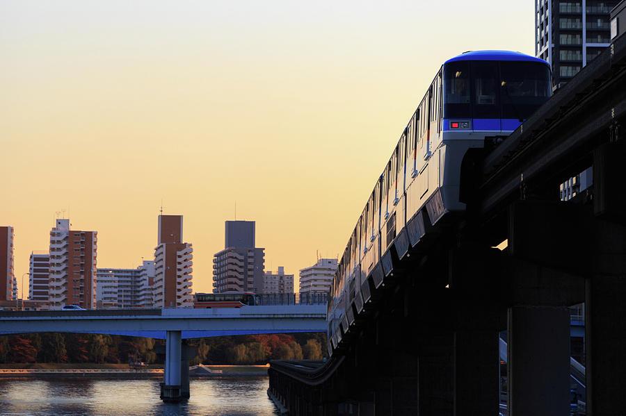 Monorail At Dusk Photograph by Ryota Kasai