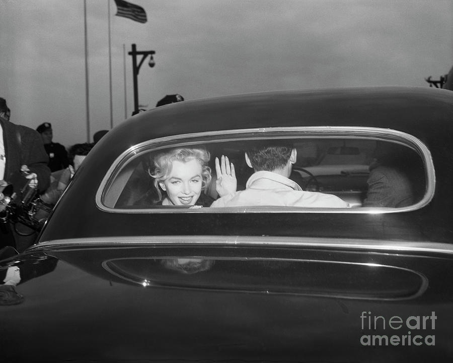 Monroe And Miller Leave Idlewild Airport Photograph by Bettmann