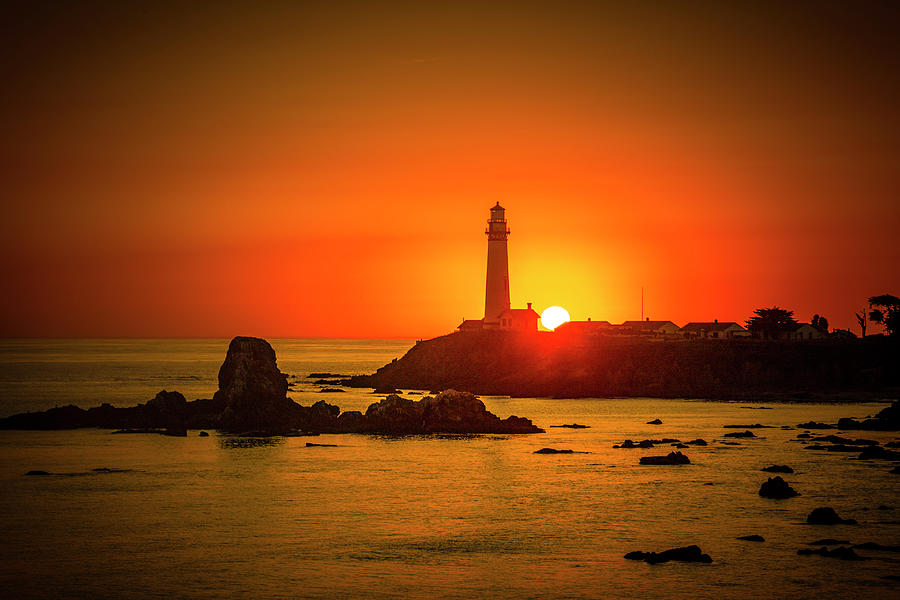 Moody Lighthouse Sunset by Garry Gay