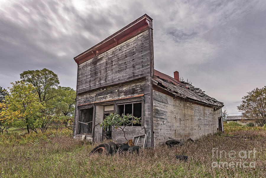 Moody Skies Over an Old Building by Sue Smith