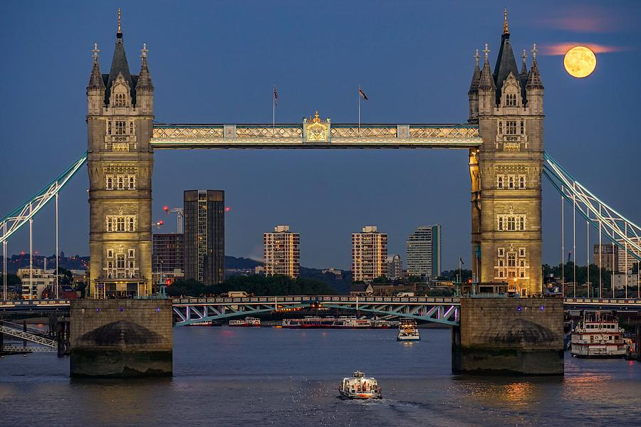 Moonrise At Tower Bridge In London, England, With A Boat Passing By Photograph