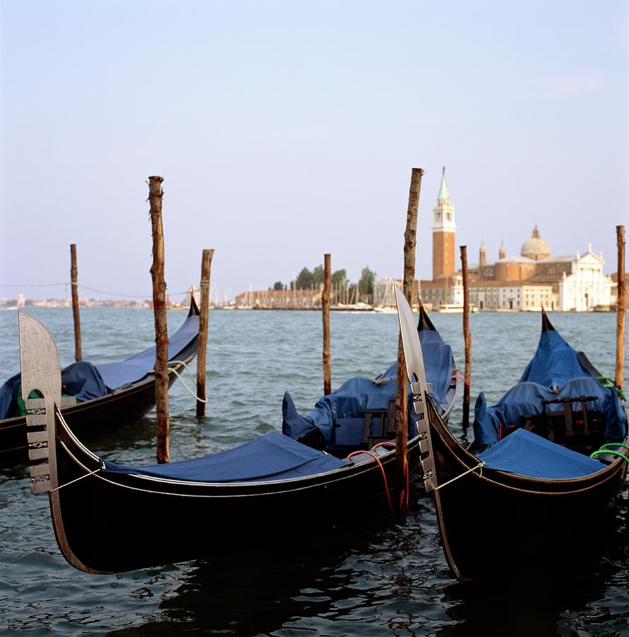 Moored Gondolas On Canal By St Mark  S Photograph by Anna Watson