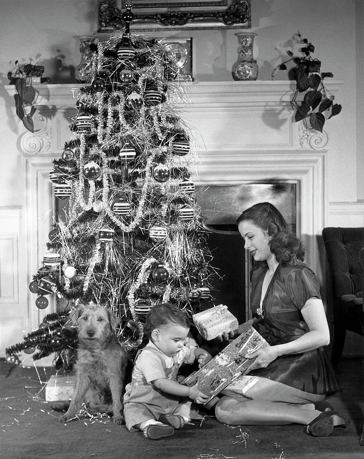 Mother And Child Opening Christmas Gifts Photograph by George Marks