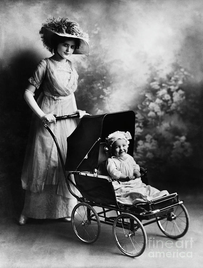 Mother With Baby In Carriage Photograph by Bettmann