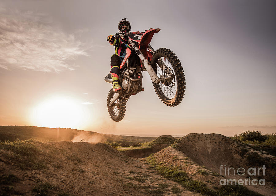 Motocross Rider Performing High Jump Photograph by Skynesher