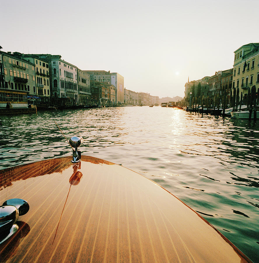 Motor Boat On The Grand Canal At Sunset Photograph by Cultura Exclusive/philip Lee Harvey