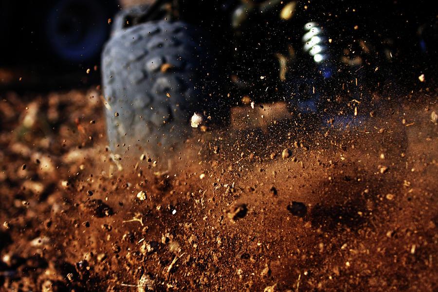 Motorbike On Dirt Road, Close Up Photograph by Yaniv Ben Simon - Photography & Design